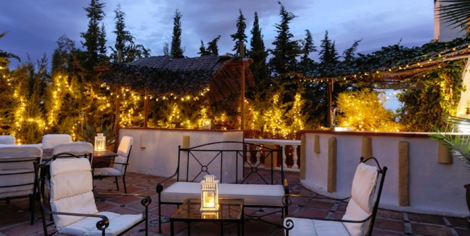 Large finca Marbella Finca Buenaventura bar and terrace at night