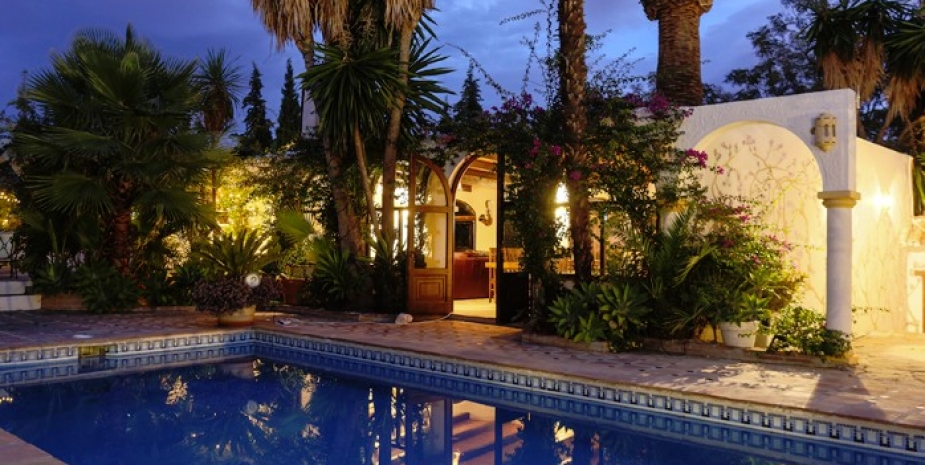 Large finca Marbella Finca Buenaventura pool and fairy lights at dusk